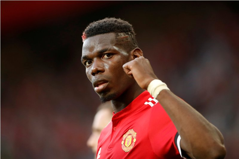 """Football Soccer - Premier League - Manchester United vs Leicester City - Manchester, Britain - August 26, 2017   Manchester United's Paul Pogba celebrates after the match    Action Images via Reuters/Carl Recine    EDITORIAL USE ONLY. No use with unauthorized audio, video, data, fixture lists, club/league logos or """"live"""" services. Online in-match use limited to 45 images, no video emulation. No use in betting, games or single club/league/player publications. Please contact your account representative for further details."""