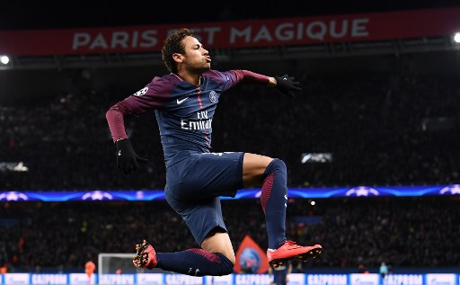-- AFP PICTURES OF THE YEAR 2017 --  Paris Saint-Germain's Brazilian striker Neymar celebrates his second goal during the UEFA Champions League Group B football match between Paris Saint-Germain (PSG) and Glasgow Celtic at Parc des Princes Stadium in Paris on November 22, 2017.  / AFP PHOTO / FRANCK FIFE