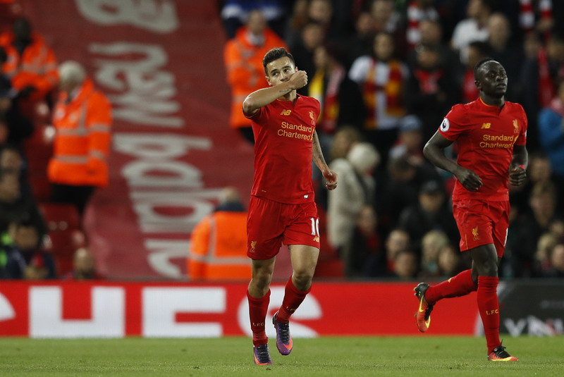 "Britain Soccer Football - Liverpool v West Bromwich Albion - Premier League - Anfield - 22/10/16 Liverpool's Philippe Coutinho celebrates scoring their second goal with James Milner and Sadio Mane  Reuters / Phil Noble Livepic EDITORIAL USE ONLY. No use with unauthorized audio, video, data, fixture lists, club/league logos or ""live"" services. Online in-match use limited to 45 images, no video emulation. No use in betting, games or single club/league/player publications.  Please contact your account representative for further details."