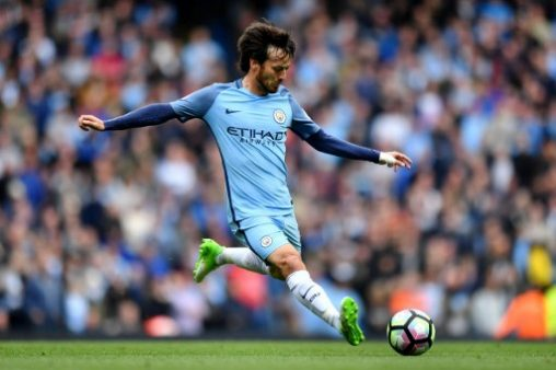Manchester City's Spanish midfielder David Silva plays the ball during the English Premier League football match between Manchester City and Leicester City at the Etihad Stadium in Manchester, north west England, on May 13, 2017. / AFP PHOTO / Anthony Devlin / RESTRICTED TO EDITORIAL USE. No use with unauthorized audio, video, data, fixture lists, club/league logos or 'live' services. Online in-match use limited to 75 images, no video emulation. No use in betting, games or single club/league/player publications.  /