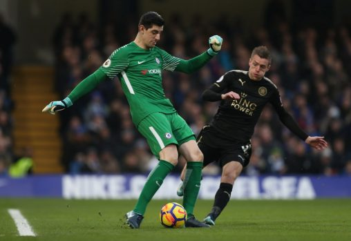 """Soccer Football - Premier League - Chelsea vs Leicester City - Stamford Bridge, London, Britain - January 13, 2018   Chelsea's Thibaut Courtois is pressured by Leicester City's Jamie Vardy as he attempts to clear the ball   Action Images via Reuters/Peter Cziborra    EDITORIAL USE ONLY. No use with unauthorized audio, video, data, fixture lists, club/league logos or """"live"""" services. Online in-match use limited to 75 images, no video emulation. No use in betting, games or single club/league/player publications.  Please contact your account representative for further details."""