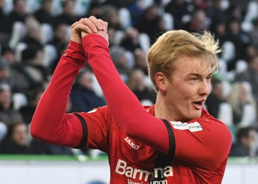 Leverkusen's German midfielder Julian Brandt celebrates scoring during the German first division Bundesliga football match VfL Wolfsburg vs Bayer Leverkusen in Wolfsburg, northern Germany, on March 3, 2018. / AFP PHOTO / dpa / Peter Steffen / Germany OUT / RESTRICTIONS: DURING MATCH TIME: DFL RULES TO LIMIT THE ONLINE USAGE TO 15 PICTURES PER MATCH AND FORBID IMAGE SEQUENCES TO SIMULATE VIDEO. == RESTRICTED TO EDITORIAL USE == FOR FURTHER QUERIES PLEASE CONTACT DFL DIRECTLY AT + 49 69 650050